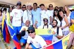 ISA President Fernando Aguerre, Minister of Sports Francisco Cevallos and Team Venezuela.  Credit: ISA / Michael Tweddle